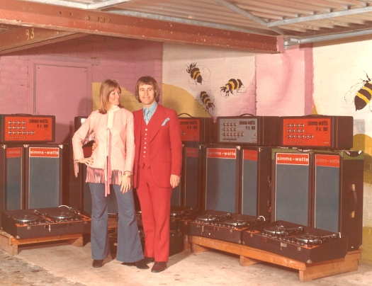 Wendy and Simon with some of the Beeline mobile disco equipment, note the bees on the garage wall!